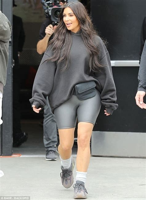 for once kim kardashian stepped out in an outfit we didnt want to kim kardashian steps out in a hoodie and biker shorts