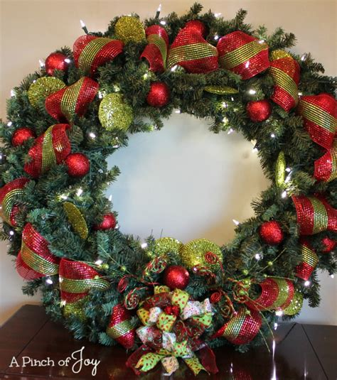 large lighted outdoor wreath  pinch  joy