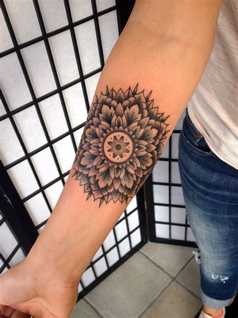 mandala forearm tattoo last light