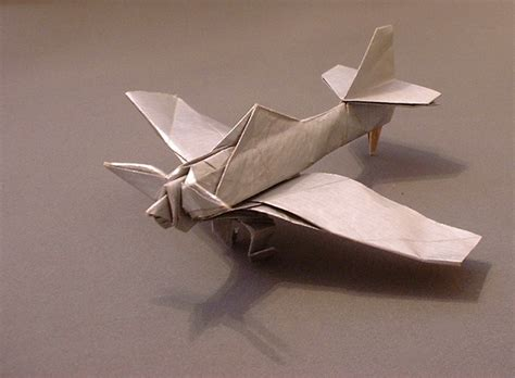 Origami Jet Plane - paper airplanes pile of photos