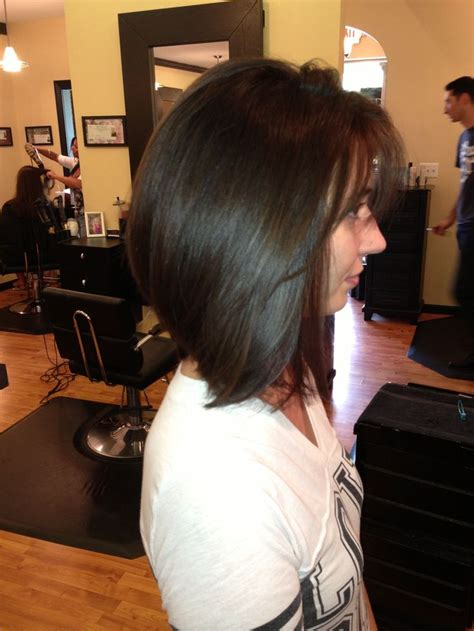 layered inverted bobs for thick hair thick hair long inverted bob lori thompson my updos