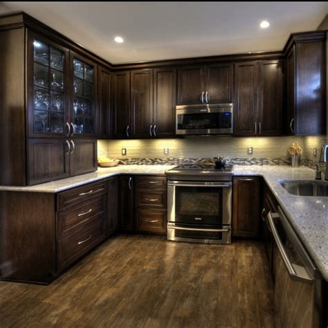 dark kitchen cabinets with dark floors cherry cabinets with a mocha finish kashmir white granite and ulvio wood look tile kitchen