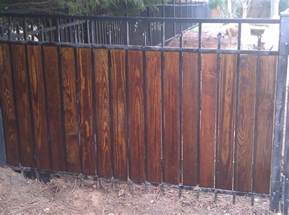 wrought iron fence with wood or composite wood privacy