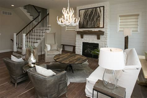 Cowhide Chair White Brick Fireplace Transitional Living Room Bia