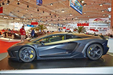 2014 mansory lamborghini aventador carbonado roadster mansory carbonado apertos an eur1 2m aventador roadster brings carbon to essen 2014 autoevolution