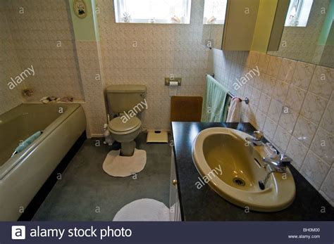 old coloured bathroom suites horizontal wide angle interior of an old fashioned 80 s