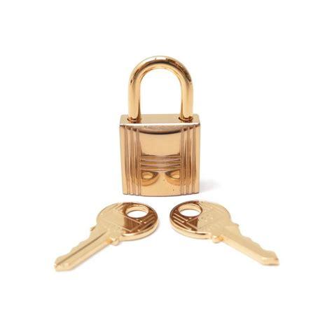 cadenas pour sac hermes cadenas hermes 160 en metal dore 2 cles pour