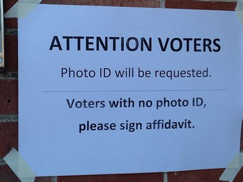 texas voter id law biased federal judge tosses texas voter id law again