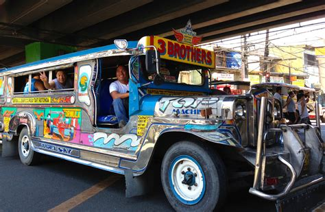 philippines jeepney brothers with happy passengers