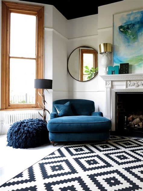 blue patterned round rug for living room all about rugs big blue comfy chair and patterned rug in living room 47
