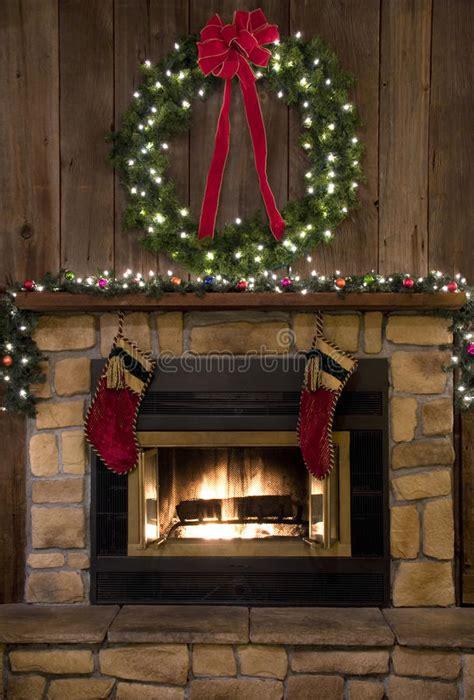 christmas fireplace hearth  wreath  stockings stock