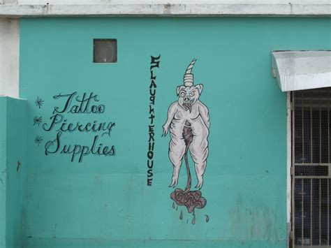 slaughter house tattoos a few interesting signs in belize city san pedro scoop