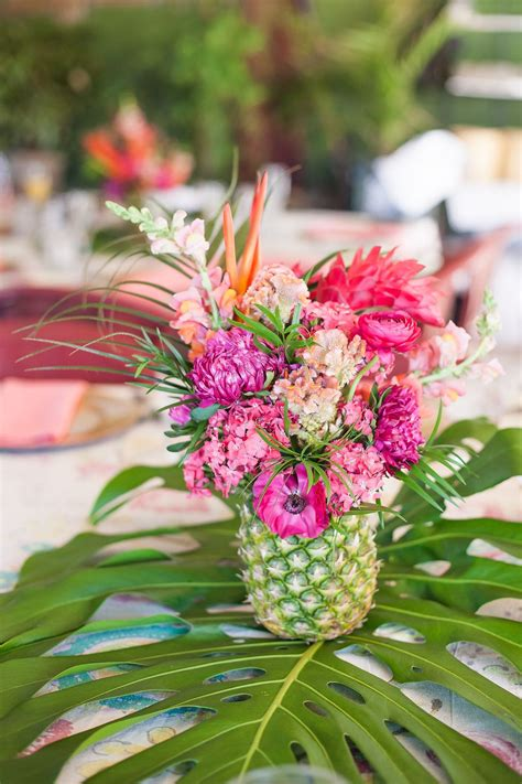 an elegant tropical bridal shower pineapple centerpiece