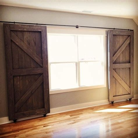 barn door window covering 25 best ideas about country window treatments on