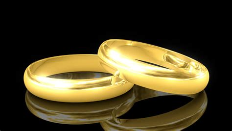 two wedding rings isolated on white rotating stock