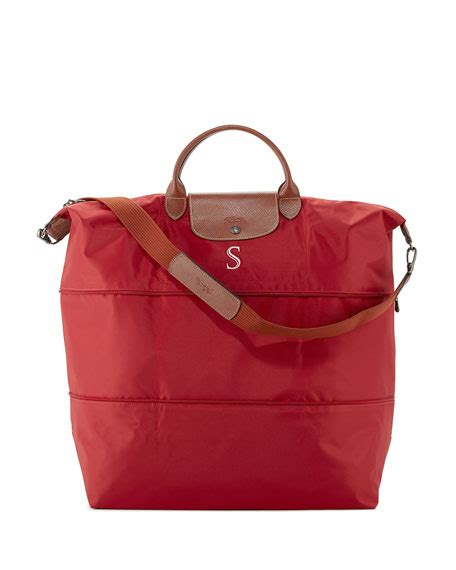 longchamp monogrammed le pliage expandable travel bag red