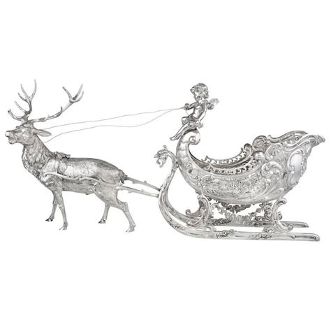 large silver christmas reindeer and sleigh table top
