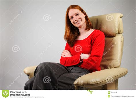 woman in armchair woman in an armchair royalty free stock photo image 5261535