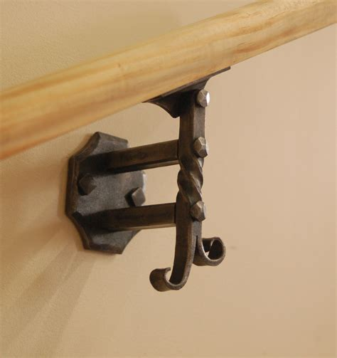 wall mounted handrail or banister bracket forged by a