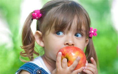 wallpaper apple girl cute little girl eating apple wallpaper cute wallpaper