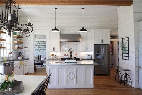 joanna gaines farmhouse kitchen the lights above the island and the white