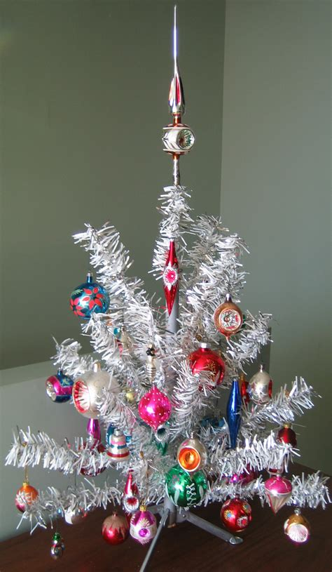 small decorated artificial christmas trees