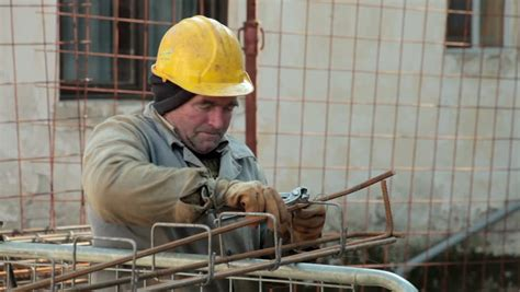 construction worker in armature at construction site up elderly laborer