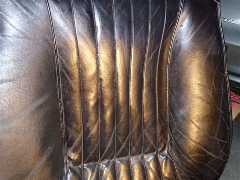 how much to replace cloth seats with leather seat repair