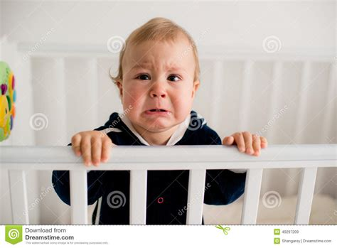 Baby Cries In Crib Baby In The Crib Stock Image Image Of Afraid