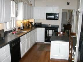 White Kitchen Cabinets With Black Appliances J Amp K Homestead Preference Poll Kitchen Appliances