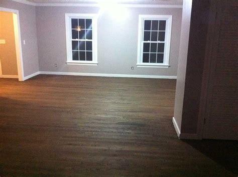 How To Mop Laminate Wood Floors by Painted Black Wood Floors Feel The Home