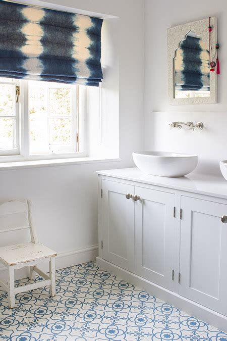 White and Blue Bathroom with Indigo Tie Dyed Roman Shade