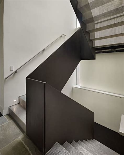 Solid Banister contemporary staircase with metal mesh risers treads bronze baluster design by deforest
