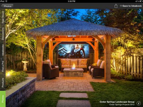 15 Dramatic Landscape Lighting Ideas Tiki Hut Backyard Backyard Tiki Hut