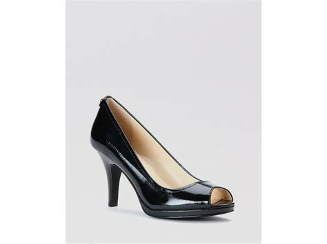 calvin klein high heels lyst calvin klein peep toe pumps kail high heel in black