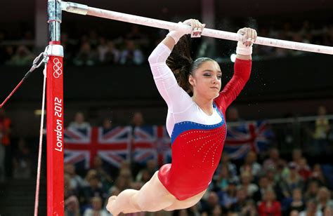gymnast gabrielle douglas donates olympic items to smithsonian cbs dc mustafina wins gold in uneven bars as drained douglas