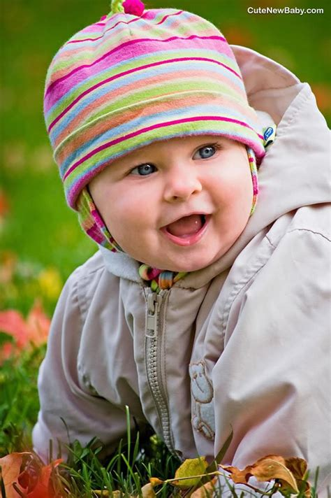 cute child colourful baby smiling photograph with grey eyes