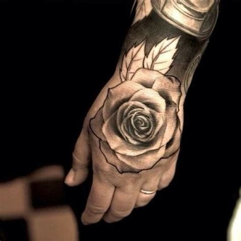 hand tattoo rose clock black hand tattoo of a rose on a man men s tattoos
