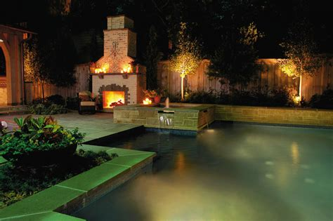 saltwater pool and spa with outdoor fireplace