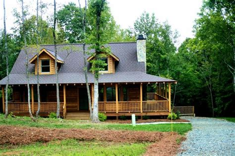 log cabin home with wrap around porch big log cabin homes i love the wrap around porch and the simple charm of this