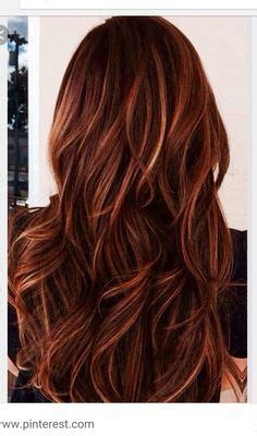 foils with red blonde chin length hair brunette hair color with burnished blonde highlights curly