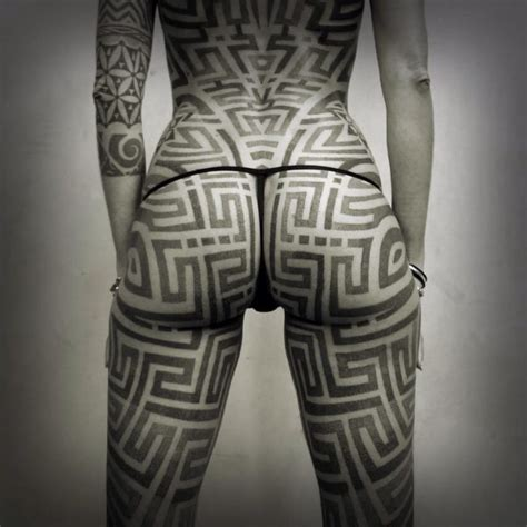 strong and bold blackwork tattoo art inked cartel