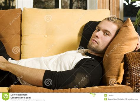 lay on the couch young man laying on couch stock image image 7185611