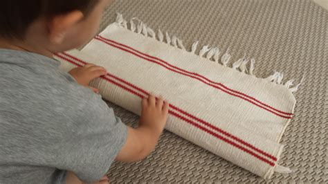 Montessori Work Rugs Me Do It Rolling Up A Work Mat Montessori Life As We