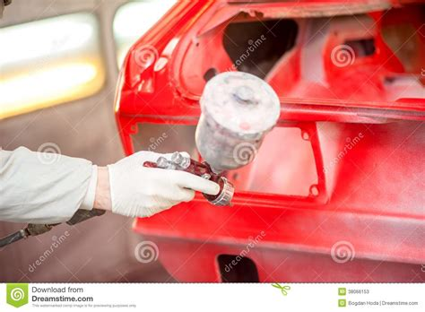 spray painting your car up of spray paint gun painting a car stock