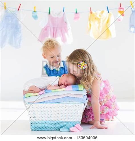 girl and boy kissing in bathroom newborn child on pile clean dry image photo bigstock