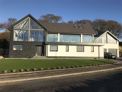 dream house construction anthracite grey galvanised steel guttering on building the