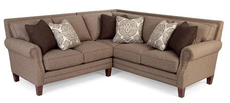 two sectional sofa with rolled arms and light brass