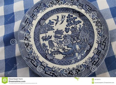blue and white pattern plates vintage blue willow china pattern plate stock photo