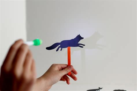 How To Make Paper Shadow Puppets - shadow puppets with green kid crafts make and takes